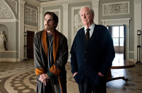 Christian Bale as Bruce Wayne and Michael Caine as Alfred in <em>The Dark Knight Rises</em>.