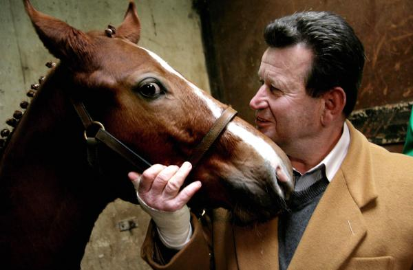 "A cloned foal named ""ET Cryozootech Stallion"" stands with Hugo Simon, Austrian former Olympic rider of ""princeps"" (initial donor) ET. The main equestrian organization has ended its ban on clones in the Olympics"