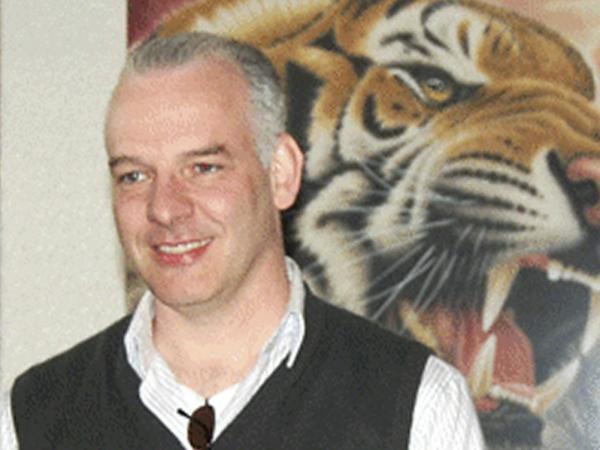 British businessman Neil Heywood, seen here at a gallery in Beijing last April, was found dead in his Chongqing hotel on Nov. 15, 2011. Heywood had ties to Bo Xilai's family, helping organize the education of son Bo Guagua, who studied at the exclusive British boarding schools Papplewick and Harrow.