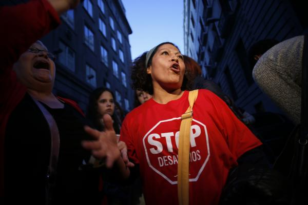 Olga Veloso protests banking giant Bankia last month in Madrid. Veloso and her neighbors have twice blocked bailiffs from evicting her from her apartment after she lost her job and stopped paying the mortgage.