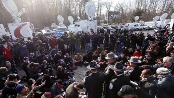 Lt. J. Paul Vance of the Connecticut State Police conducts a news briefing Saturday in Newtown, Conn. The strategy for dealing with the wave of news media in Newtown echoes that of some past tragedies, experts say.