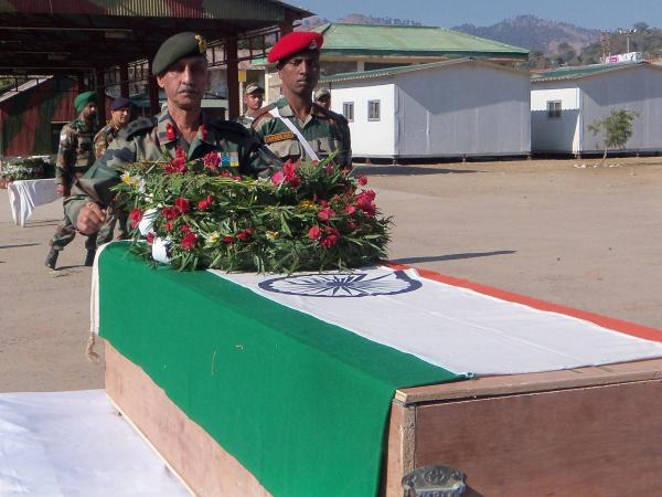 Wednesday in Rajouri, India, officers paid their respects at the coffin of one of two Indian soldiers killed Tuesday in a skirmish with Pakistani troops.