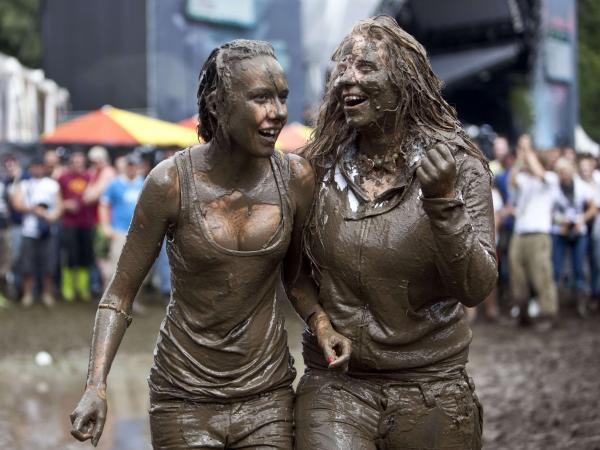 Looks like these two attendees at the 2009 Music Openair Festival St. Gallen in Switzerland couldn't resist jumping in the mud, either.