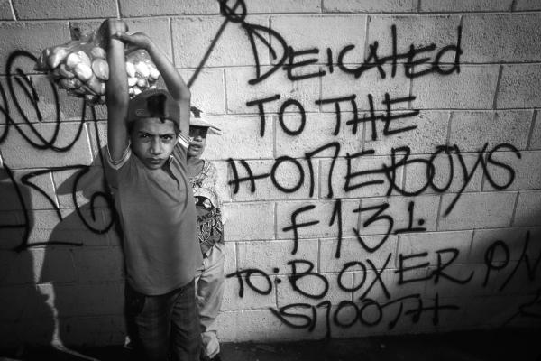 Gang graffiti in English begin to appear in barrios in San Salvador, 1993.
