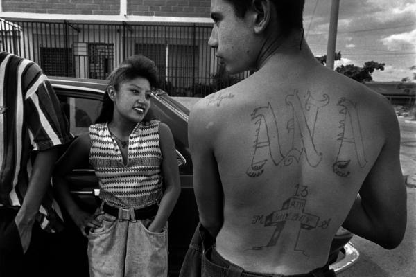 After Jose Bola–os was murdered, his youngest brother, Edgar, tattooed a tombstone memorial on his back and began hanging out in gang crash pads in Apopa, El Salvador, 1995.