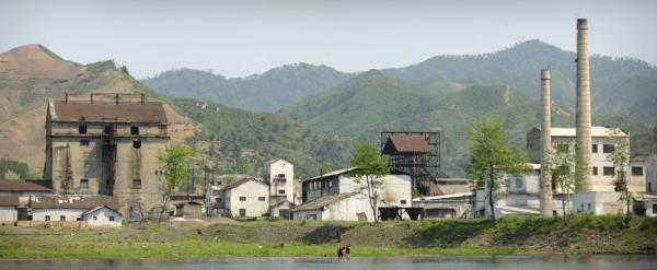 An idle North Korean factory, seen from the Chinese border.