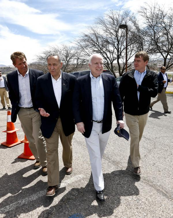 "From left, Sen. Jeff Flake, R-Ariz., Sen. Chuck Schumer, D-NY, Sen. John McCain, R-Ariz., and Sen. Michael Bennett, D-Colo, arrive at a news conference after their tour of the Mexico border with the United States on Wednesday in Nogales, Ariz. The senators are part of the ""Gang of Eight,"" a larger group of legislators collaborating on changes to immigration."