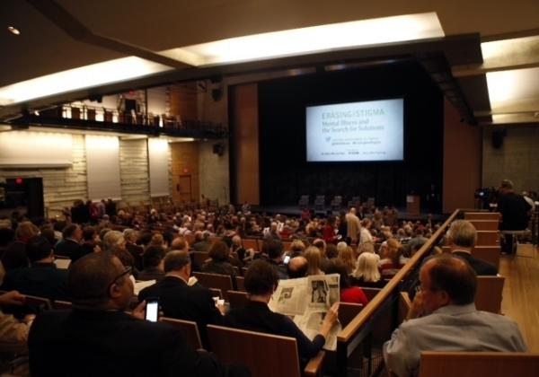 "Audience members wait in the Dallas City Performance Hall for the public forum, ""<a href=""http://www.kera.org/erasingthestigma/"">Erasing the Stigma: Mental Illness and the Search for Solutions</a>,"" to begin."