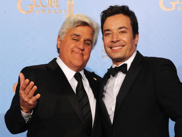 Jay Leno (left) and Jimmy Fallon at the Golden Globe Awards in January. Next year, Fallon will be taking Leno's place on <em>The Tonight Show</em>, NBC says.