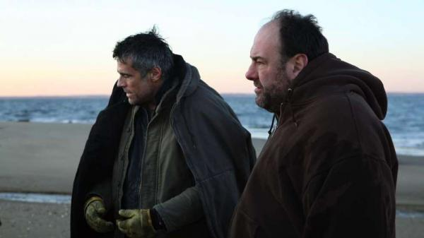 The mysterious Jacques (Edoardo Costa, left) upends Bailey's (James Gandolfini) life when he arrives in the latter's seaside New Jersey town in <em>Down the Shore</em>.