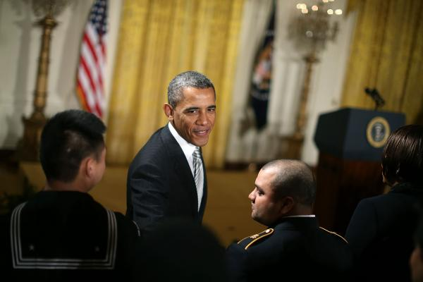 U.S. President Barack Obama greets newly sworn in United States citizens during a naturalization ceremony in the East Room of the White House on March 25, 2013 in Washington.