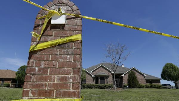Crime scene tape is seen outside the home of Kaufman County District Attorney Mike McLelland. McLelland and his wife Cynthia were murdered at their home Saturday.