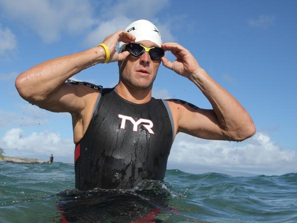 Lance Armstrong warms up for the swimming leg of the 2011 Xterra World Championship triathlon in Kapalua, Hawaii (before he was banned from most competitions). This weekend, he'll swim in a Texas meet for masters swimmers.