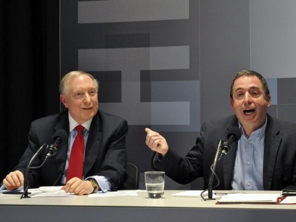 James A. Dorn (left) and Russ Roberts argue for abolishing the minimum wage in an <em>Intelligence Squared U.S.</em> debate.