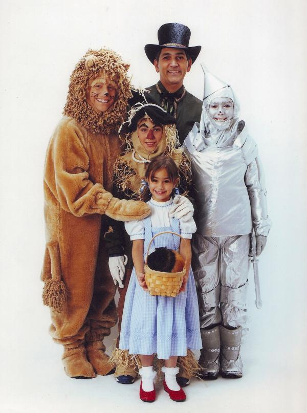 """The whole family dressed up one year for Halloween — Dad was the Wizard, Mom was the Lion, oldest son was Tin Man, middle son was scarecrow, daughter was Dorothy, and guinea pig was Toto."" — submitted by <a href=""http://amberink.tumblr.com/"">amberink</a>"