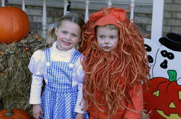 """My twins dressed up as Dorothy and the Lion one year. The Lion suit has now been passed down through three generations."" — submitted by <a href=""http://barteleye.tumblr.com/"">barteleye</a>"