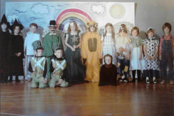 """This is a photo from 1977 when the 1st-grade class of Miss Franceschetti and the kindergarten class of Mrs. MacNabb took on the challenge of the FULL Wizard of Oz script and musical production. ... Recently the photo was shared on Facebook reconnecting the cast who shared their fond memories of being a part of the play over 35 years ago."" — Debbie (Coccia) Young, 42, Wicked Witch of the West"