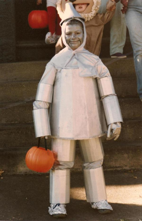"""I have always been terrified of <em>The Wizard of Oz.</em> My mom made me this costume at age 8 to go along with my siblings and cousins as a group for trick-or-treating that year. Because every 8-year-old girl wants to be the Tin Man for Halloween? My 'body' was made of a Styrofoam container a rose bush came in. I couldn't sit or go to the bathroom all day."" — Nina Schmidt, 35"