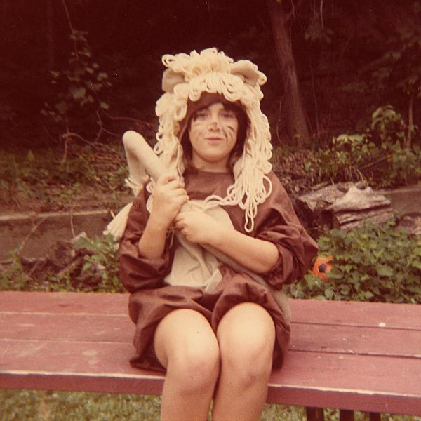 """My name is Jenny Barker Devine and I grew up in Council Bluffs, Iowa. We had the perfect back porch for staging productions. Over the years we did such classics as<em> Lady and the Tramp</em> and <em>The Wizard of Oz</em>. This is my sister, Karen Barker Crowley, as the Cowardly Lion, ca. 1985."" — Jenny Barker Devine"