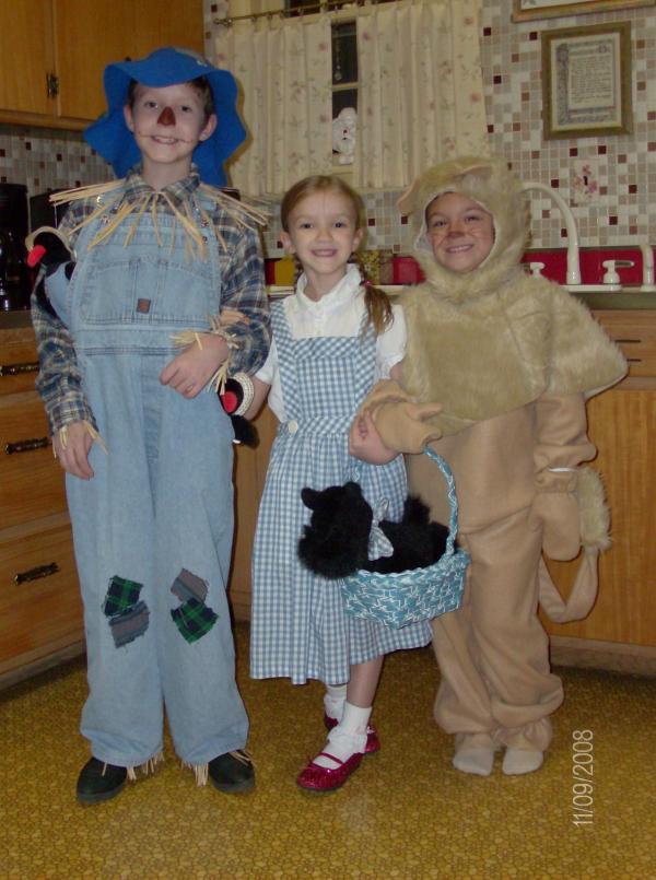 """2008: Mom made the Dorothy costume about 10 years earlier for older sister and made the Lion costume this year; Dad assembled the Scarecrow costume."" — submitted by David W."