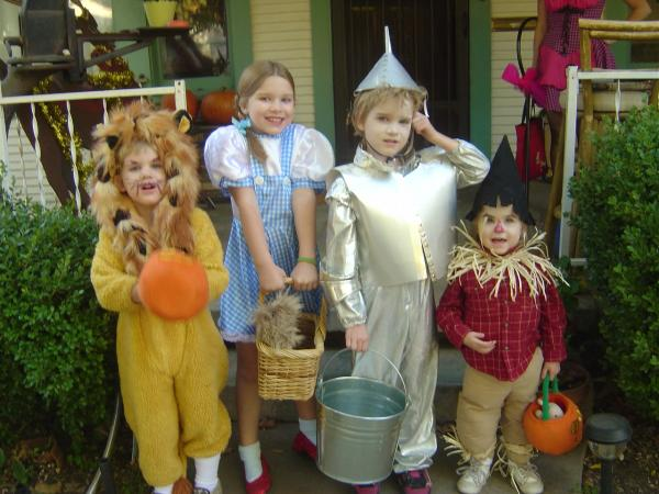 """My four oldest grandchildren, the Weitzes of Oz, on Halloween 2006 in Stockton, Calif. These costumes were a collaboration by me and their paternal grandmother. They were actually the second generation of <em>Wizard of Oz</em> trick-or-treaters. Their mom, aunt and two friends did it first in 1984."" — Ava Simpson"