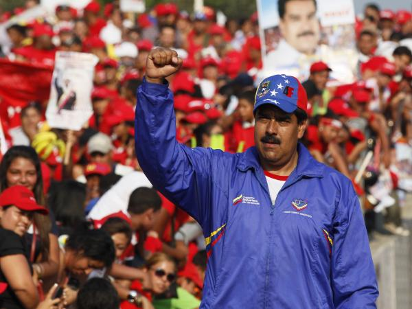 Nicolas Maduro, Venezuela's acting president and Chavez's hand-picked successor, raises his fist during a presidential election campaign rally in Catia La Mar, Venezuela, on Tuesday.