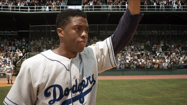 Brooklyn Dodgers first baseman Jackie Robinson (Chadwick Boseman) acknowledges the crowd in <em>42</em>.