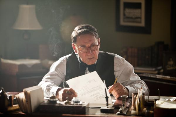 A heavily made-up Harrison Ford plays Brooklyn Dodgers manager Branch Rickey in <em>42</em>. The real-life Rickey helped convince a wary Robinson that the time was right for a racially integrated major league.