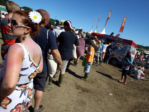 Customers line up for an ice cream van at the 2011 Glastonbury Music Festival in southwest England.