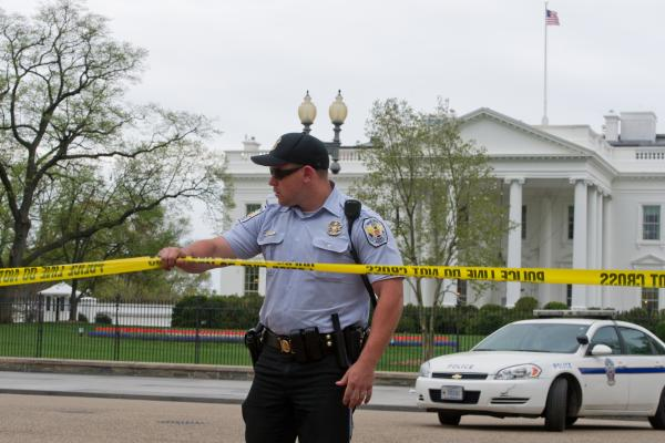 A policeman secures the area in front of the White House in Washington, D.C., after blasts in Boston. The block around the White House has been temporarily closed to pedestrians.