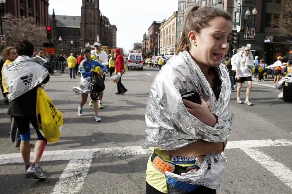 An unidentified runner leaves the marathon course, crying, near Copley Square following the explosion.