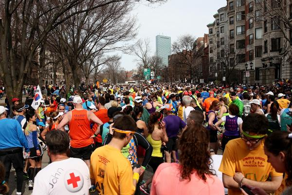 Runners gather near Kenmore Square, about a mile away from the finish line, after two bombs exploded during the Boston Marathon.