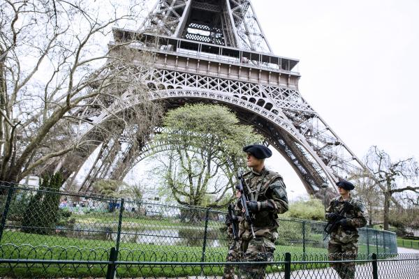French soldiers patrol Tuesday in front of the Eiffel Tower in Paris. Officials in major cities around the world have increased security after the explosions in Boston.