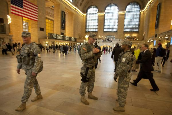 Members of the U.S. Army National Guard patrol Grand Central Terminal in New York City. NPR's Dina Temple-Raston reports investigators are being cautious about what they reveal, and warn it may be some time before they can say with certainty who they think was behind the attack.