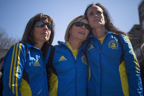 Boston Marathon runners Tammy Snyder (from left), Diane Deigmann and Lisa Kresky-Griffin embrace at the barricaded entrance at Boylston Street, near the finish line of the Boston Marathon.