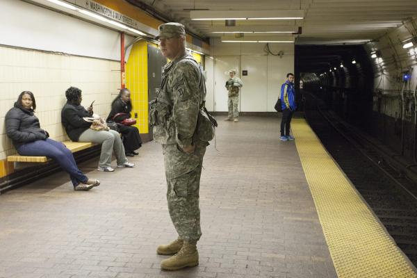 A member of the Massachusetts National Guard patrols the State Street subway station Tuesday, as the investigation continues into the explosions at the Boston Marathon.