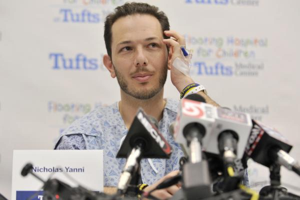 Nicholas Yanni, 32, of Boston, speaks to reporters at Tufts Medical Center in Boston. Yanni, and his wife, Lee Ann Yanni, 31 were among the 14 patients injured in the bombing at the finish of the Boston Marathon who were treated at Tufts.