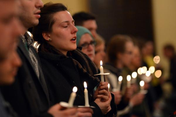A woman cries during a candlelight interfaith service at Arlington Street Church honoring the victims of the Boston Marathon bombings.