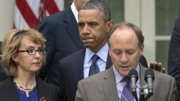 "Mark Barden, the father of a young Newtown, Conn., shooting victim, speaks at a White House news conference on Wednesday, with President Obama and former Rep. Gabby Giffords. Obama denounced the Senate's defeat of a measure to expand background checks for gun buyers. ""This was a pretty shameful day in Washington,"" he said."