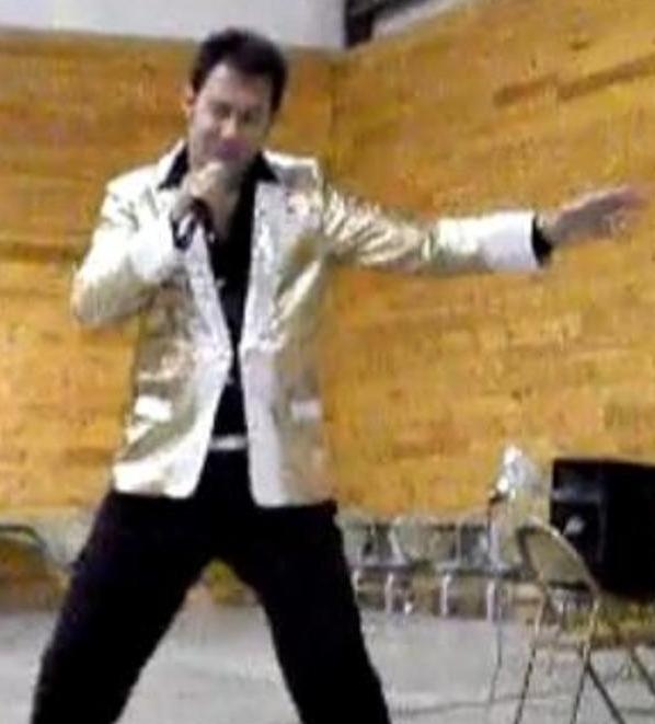 "A screen image from a video on the YouTube channel where Paul Kevin Curtis has posted clips of his performances — in this case, as ""Elvis."""