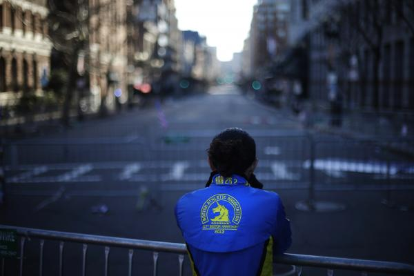 Lizzie Lee pauses near the finish line of the explosions, which killed at least three and injured more than 150. Lee said she had almost completed the marathon before the blasts.