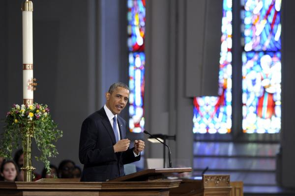 "President Obama speaks at the ""Healing Our City"" interfaith service at the Cathedral of the Holy Cross in Boston on Thursday. The program honored the victims of Monday's marathon bombing and those who came to their aid."
