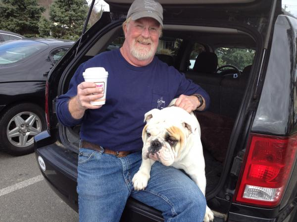 Mike Cragin and his bulldog, Truman, stopped by the Dunkin' Donuts in Newtown, Conn., on Thursday. After the elementary school shooting in December, Cragin came to the same place and put up a sign inviting people to hug his dog.