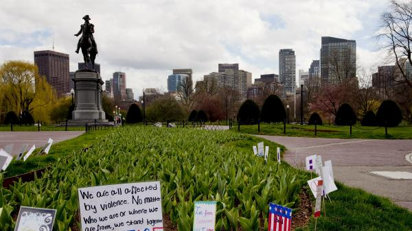 Boston's Public Garden was devoid of people midday Friday. Mayor Thomas Menino and Massachusetts Gov. Deval Patrick asked all residents of Boston and several surrounding towns to remain at home as investigators searched for a suspect in the marathon bombings.