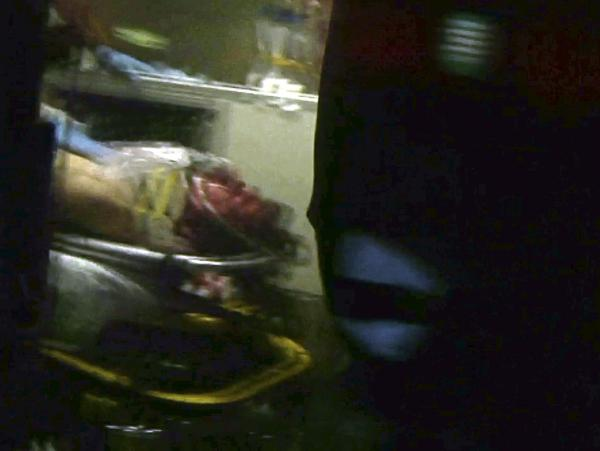 A still frame from video shows Boston Marathon bombing suspect Dzhokhar Tsarnaev through an ambulance window after he was captured in Watertown, Mass., on Friday.