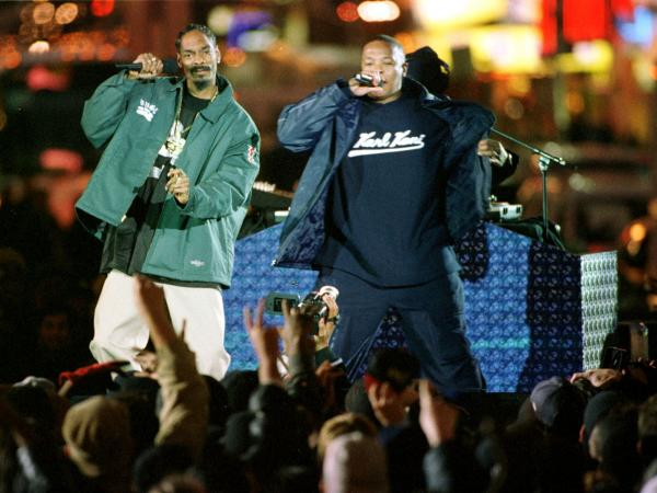 Dr. Dre (right), and Snoop Dogg (left), perform on Broadway in Times Square, New York City as part of MTV's Spankin New Music Week.