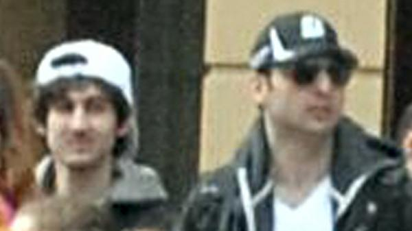 Dzhokhar (at left) and Tamerlan Tsarnaev allegedly killed an MIT police officer, carjacked a vehicle and engaged in a gun battle with police soon after authorities distributed this image of the brothers walking near the finish line of the Boston Marathon just before two bombs exploded. Tamerlan, 26, died from injuries he received. Dzhokhar, 19, was captured Friday night.