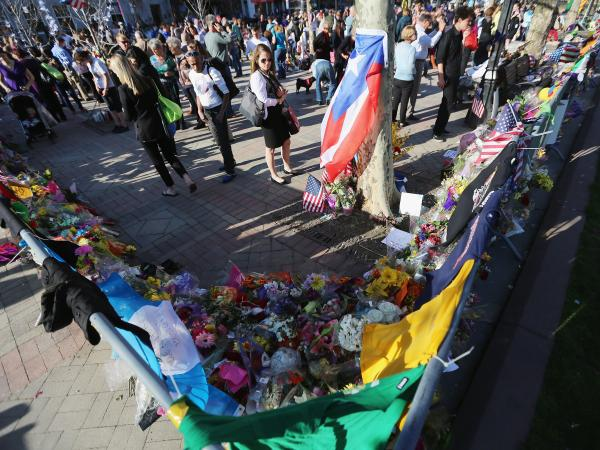 In Boston's Copley Square on Wednesday, people gathered at a makeshift memorial to those killed and injured in the April 15 marathon bombings.