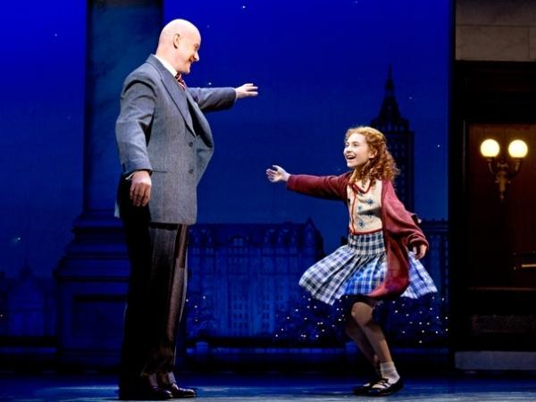 Anthony Warlow as Oliver Warbucks and Lilla Crawford as Annie in the recent Broadway revival of <em>Annie</em>. The show is almost a version of <em>Oliver!</em> in drag, Mondello said in his first-ever commentary for <em>All Things Considered.</em>