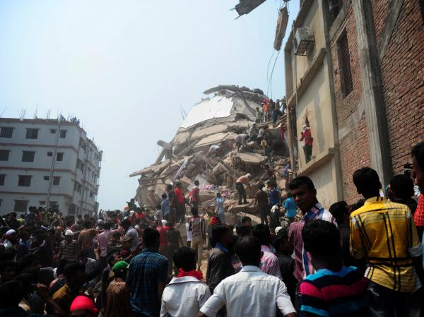 Bangladeshi volunteers and rescue workers at the site of the factory on Friday.